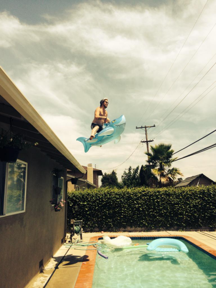 Roof jump into pool riding shark floaty